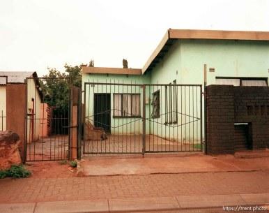 Street scene. Green house and gate.