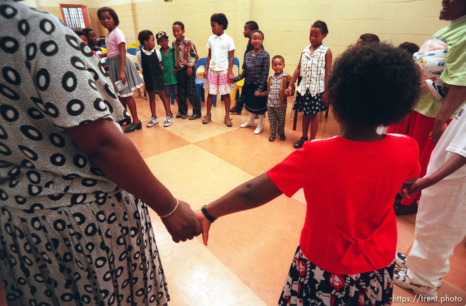 Kids in LDS primary sing songs and hold hands.