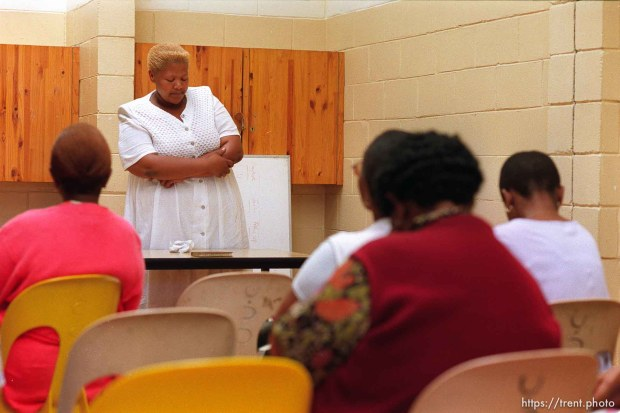 Sindiswa Mene gives the closing prayer in an LDS relief society meeting.