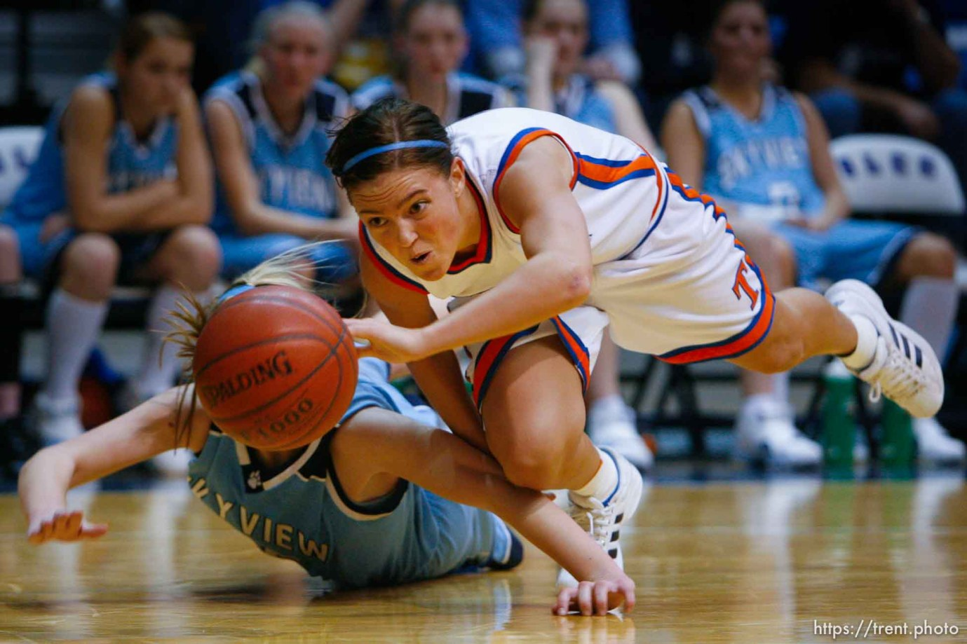 Timpview's Gabrielle Pinegar (right) dives for the loose ball, knocking it away from Sky View's Liz Malmberg. Taylorsville - Timpview vs. Sky View High School, 4A Girls State Basketball Championships at Salt Lake Community College.