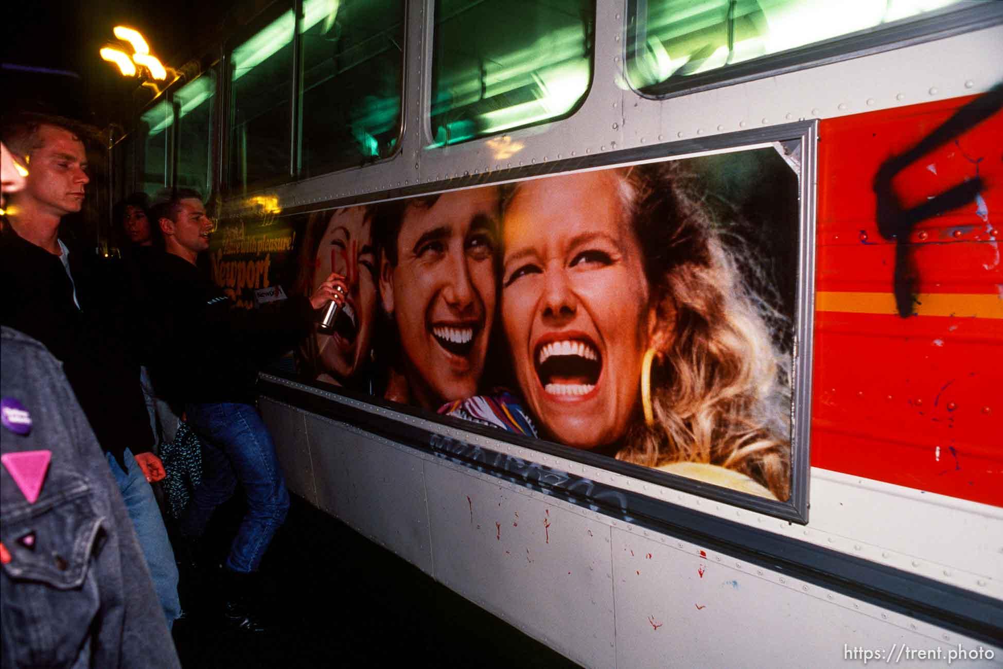 Spray painting a MUNI bus during Anti-war Gulf War protests. p