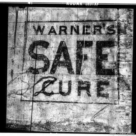 Warner's safe cure stencil. Walking around with Mamiya