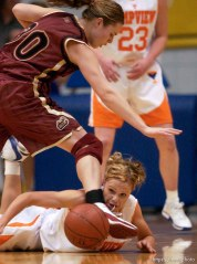 Taylorsville - Timpview's Jessica Harmon (bottom) and Mountain View's Mallary Gillespie scramble for a loose ball. Mountain View defeats Timpview girls high school basketball, 4A state championship game, Saturday afternoon at Salt Lake Community College. Photo by Trent Nelson/The Salt Lake Tribune; 02.28.2004