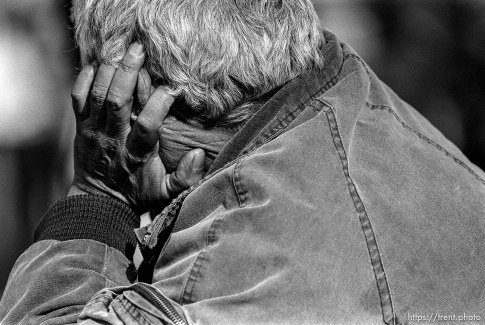 Homeless man's back and head and hand
