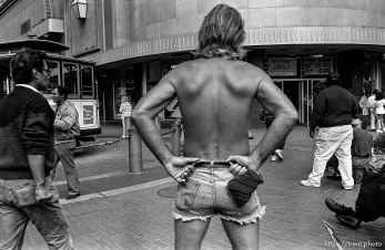 Shirtless man. Leica hip shots on the street.