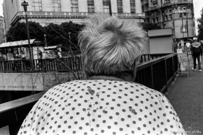 Woman's head with bloody gown. Leica hip shots on the street.