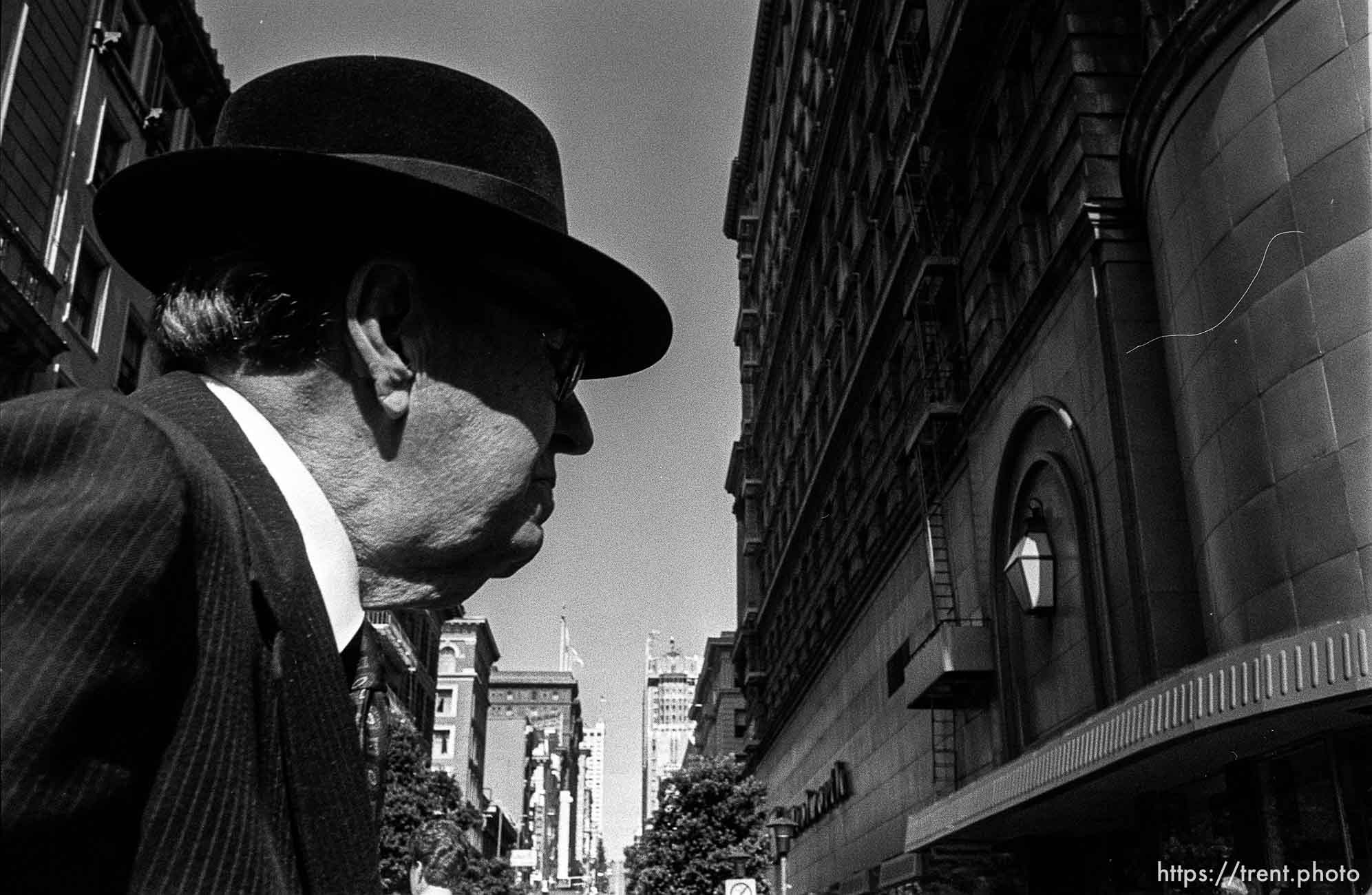Man with hat. Leica hip shots on the street.