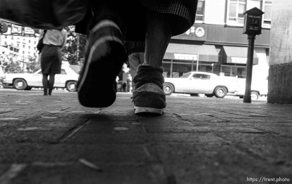Woman's feet while walking. Leica hip shots on the street.