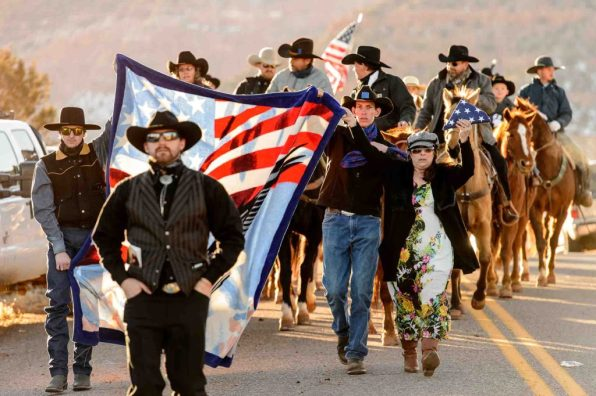 "Trent Nelson | The Salt Lake Tribune Riders on horseback ride in a procession following the funeral for Robert ""LaVoy"" Finicum, in Kanab, Friday February 5, 2016. Finicum was shot and killed by police during a January 26 traffic stop. Finicum was part of the armed occupation of an Oregon wildlife refuge."