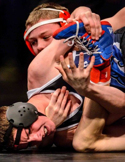 Trent Nelson | The Salt Lake Tribune Hunter Thacker, Altamont (rear) vs. Zackary Julander, Panguitch (front) in the 1A 120 championship match at the Class 3A, 2A and 1A high school wrestling tournament at the UCCU Center in Orem, Saturday February 13, 2016.