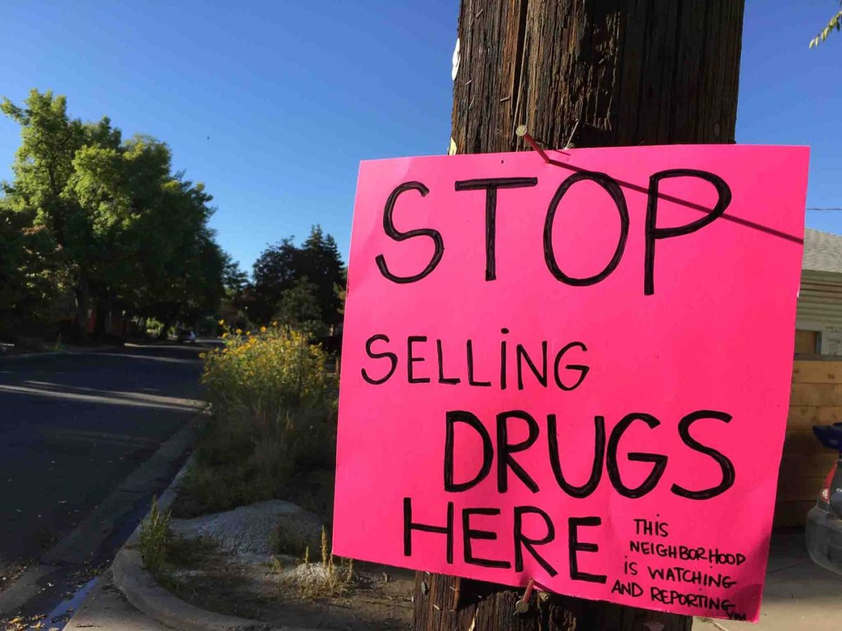 sign: stop selling drugs here. this neighborhood is watching and reporting, Monday September 19, 2016.
