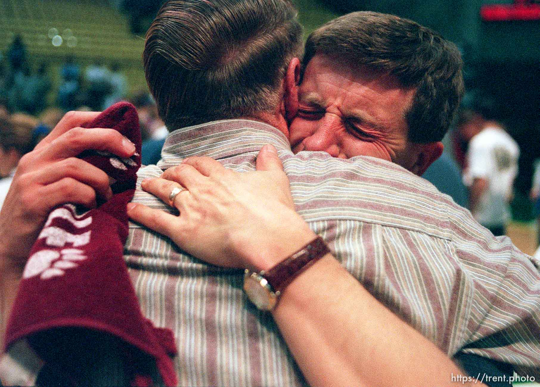 """Craig Burr (right) weeps as he embraces his father after the North Sevier boys basketball team won the state championship. Burr has a son, Ryan, on the team and coached most of the boys when they were in 7th and 8th grade. Burr can be found at the teams' games, camcorder in hand. """"They are a good bunch of boys."""""""