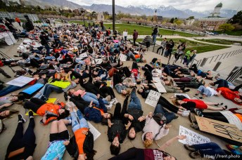 (Trent Nelson | The Salt Lake Tribune) High school students staged a die-in at the Utah State Capitol in Salt Lake City to mark the anniversary of the Columbine High School massacre and call for action against gun violence, Friday April 20, 2018.