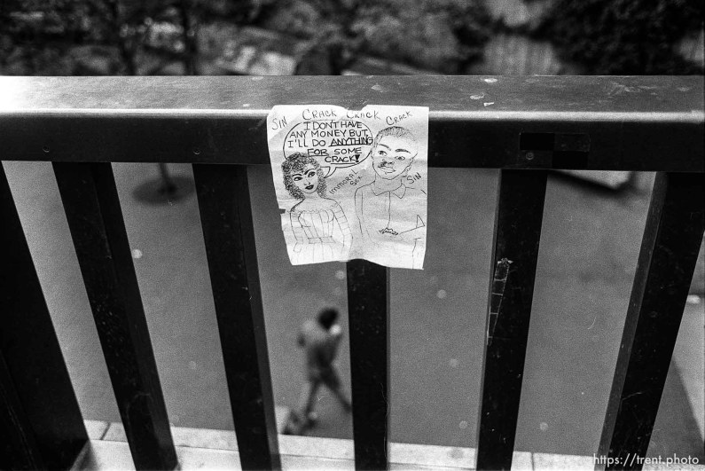 """I'll do anything for some crack!"" flier on railing."