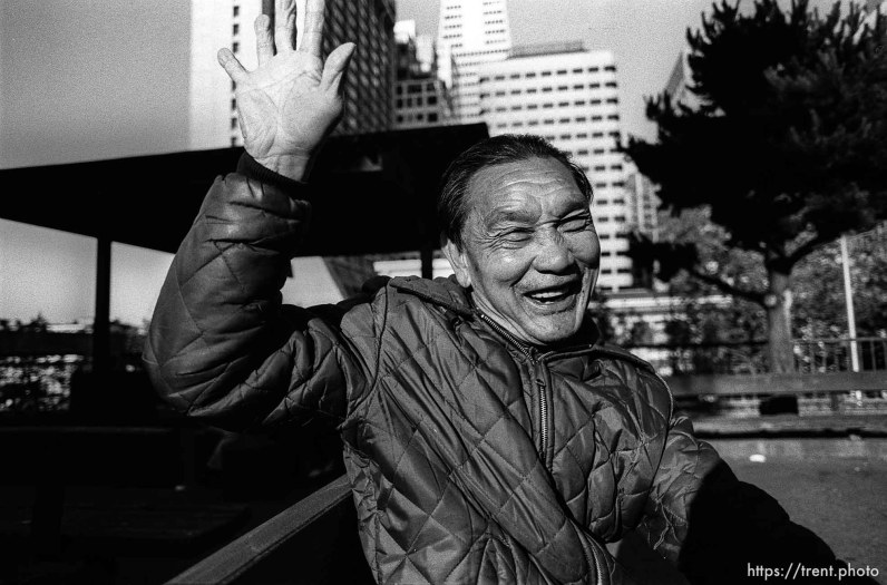 Old asian man waving.