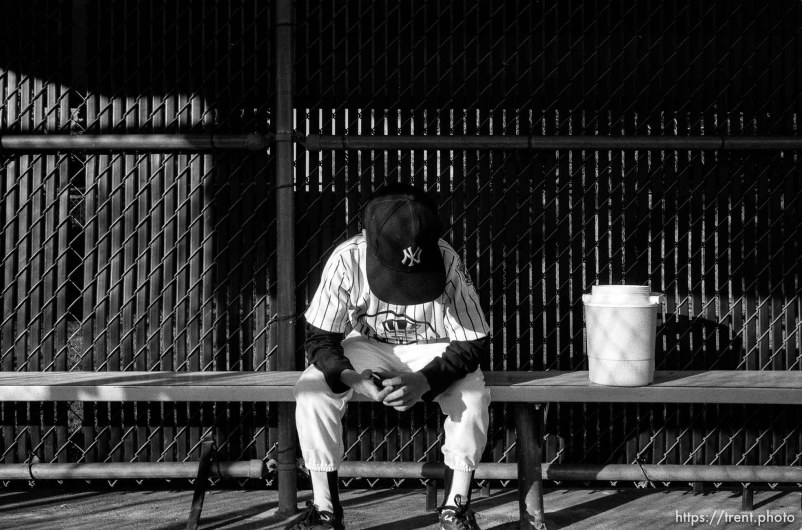 Player in dugout with head down at Yankees game
