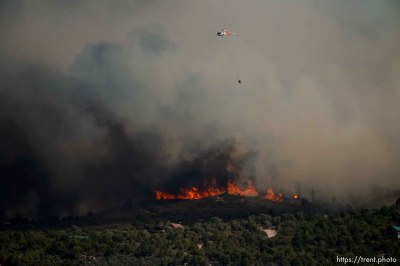 (Trent Nelson | The Salt Lake Tribune) Helicopters make drops on the Dollar Ridge Fire near Fruitland in Duchesne County, Tuesday July 3, 2018.