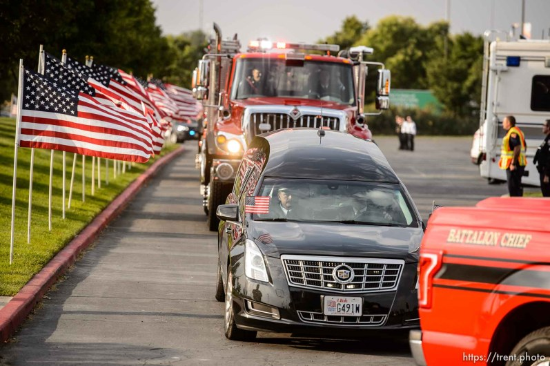 (Trent Nelson | The Salt Lake Tribune) The procession arrives for the funeral services for Battalion Chief Matthew Burchett at the Maverik Center in West Valley City, Monday Aug. 20, 2018.