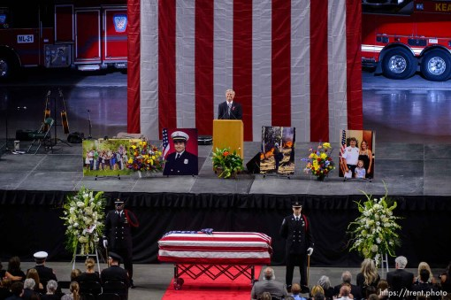 (Trent Nelson | The Salt Lake Tribune) Speaking at his son Matthew Burchett's funeral, Tom Burchett smiles as voicemails left by Matthew are played. Funeral services for Battalion Chief Matthew Burchett at the Maverik Center in West Valley City, Monday Aug. 20, 2018.