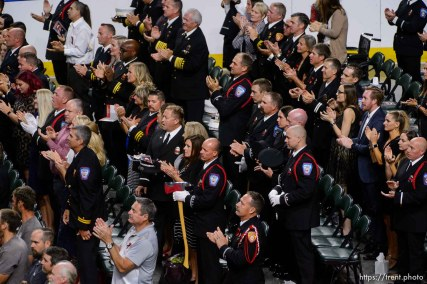 (Trent Nelson | The Salt Lake Tribune) Audience members applaud at the funeral services for Battalion Chief Matthew Burchett at the Maverik Center in West Valley City, Monday Aug. 20, 2018.