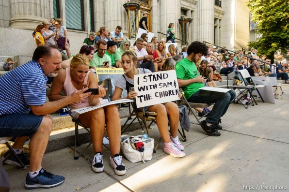 (Trent Nelson | The Salt Lake Tribune) People watch as Sam Young speaks on a livestream after his hearing. People gathered in front of the LDS Church Administration Building Salt Lake City, Sunday Sept. 9, 2018 in support of Sam Young. Young was in a disciplinary hearing tonight after he made calls for changes to the church's youth interview process.