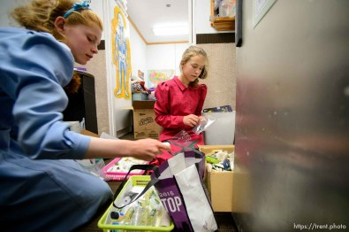 Trent Nelson | The Salt Lake Tribune Carol and Netty, FLDS members, pack donations into relief kits that will be given to children evicted from UEP Trust homes, in Colorado City, AZ, Monday May 8, 2017.
