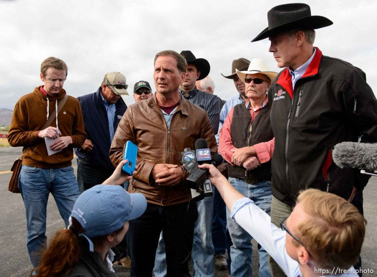Trent Nelson | The Salt Lake Tribune Secretary of the Interior Ryan Zinke, news conference at the Kanab Airport, Wednesday May 10, 2017. matt piper, left, chris stewart speaking