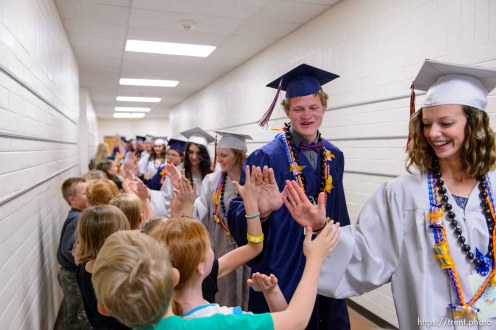 Trent Nelson | The Salt Lake Tribune Water Canyon High School graduates walk a procession of high-fives through Water Canyon Elementary prior to the high school's graduation ceremony in Hildale, Monday May 22, 2017. Two years ago the school had one graduate, this year twenty-five.