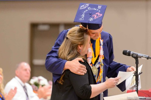 Trent Nelson | The Salt Lake Tribune shirlee draper presents uep trust scholarship to roy jessop at Water Canyon High School's graduation ceremony in Hildale, Monday May 22, 2017. Two years ago the school had one graduate, this year twenty-five.