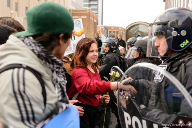 (Trent Nelson | The Salt Lake Tribune) A protester shakes hands with a police officer after a rally against a visit by President Donald Trump, Monday December 4, 2017.