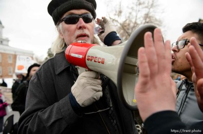 (Trent Nelson | The Salt Lake Tribune) Protesters confront a man trolling them with a megaphone at a rally against a visit by President Donald Trump, Monday December 4, 2017.