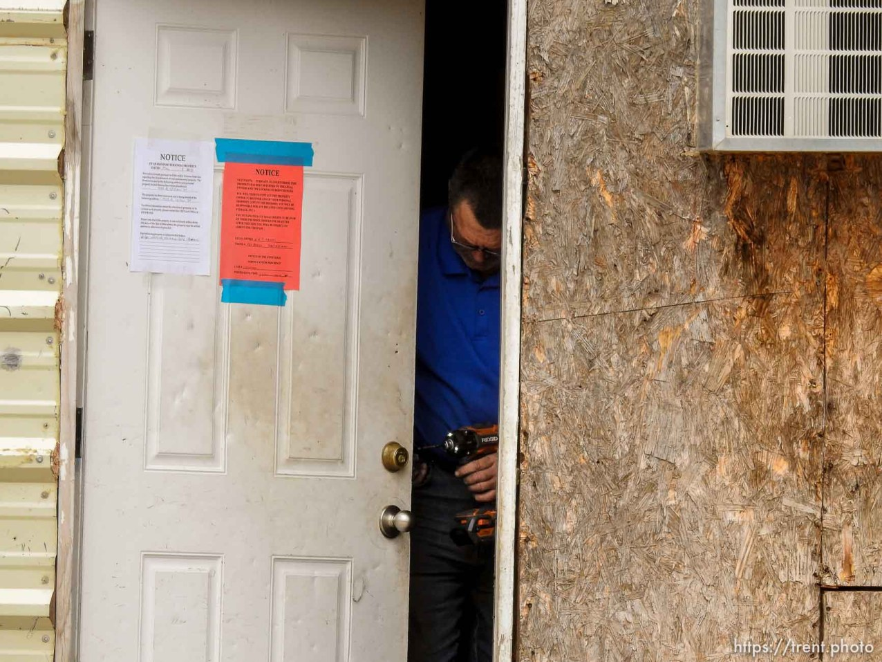 Trent Nelson   The Salt Lake Tribune Locksmith Kelvin Holdaway changes the locks on a UEP Trust property in Hildale, Tuesday May 9, 2017.