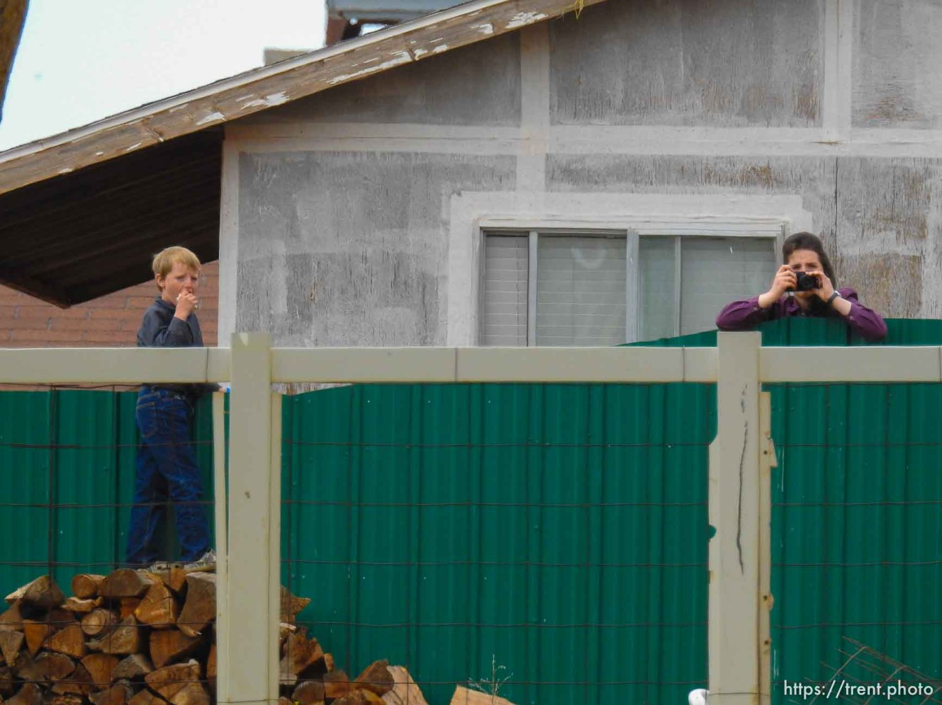 Trent Nelson   The Salt Lake Tribune An FLDS girl photographs as the locks are changed on an empty home in Colorado City, AZ, Tuesday May 9, 2017.