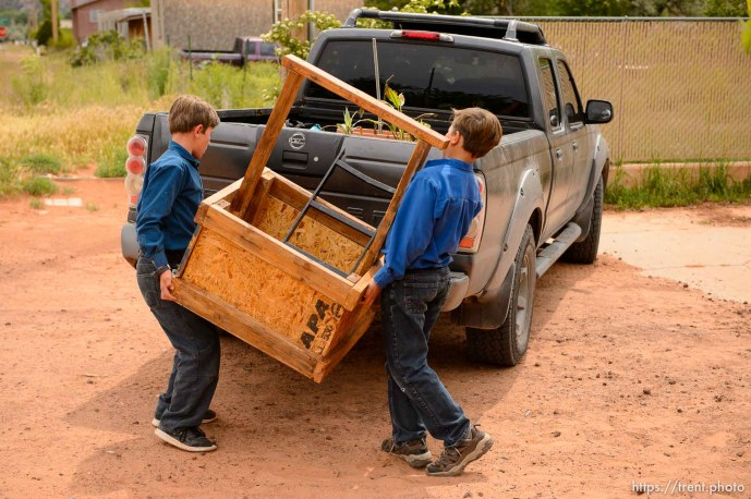 Trent Nelson   The Salt Lake Tribune An FLDS woman confronts UEP agent Ted Barlow and Mohave County Constable Mike Hoggard as they evict her from her home in Colorado City, AZ, facing eviction, Tuesday May 9, 2017. Two boys load up belongings.