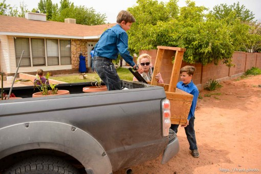 Trent Nelson | The Salt Lake Tribune An FLDS woman confronts UEP agent Ted Barlow and Mohave County Constable Mike Hoggard as they evict her from her home in Colorado City, AZ, facing eviction, Tuesday May 9, 2017. Two boys load up belongings, with help from Christine Marie Katas.