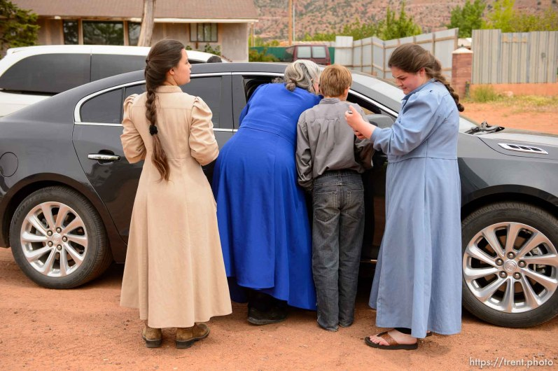 Trent Nelson | The Salt Lake Tribune An FLDS woman confronts UEP agent Ted Barlow and Mohave County Constable Mike Hoggard as they evict her from her home in Colorado City, AZ, facing eviction, Tuesday May 9, 2017. Locksmith Kelvin Holdaway in blue shirt. Onlookers