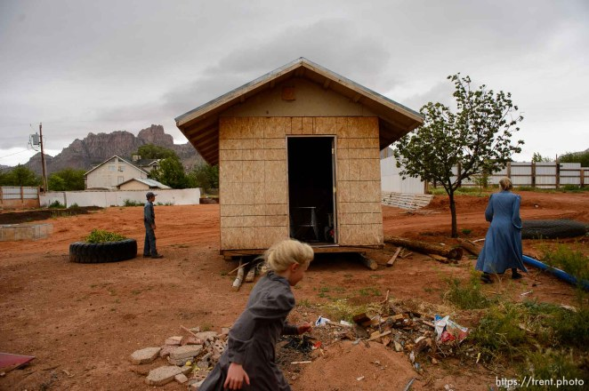 Trent Nelson   The Salt Lake Tribune An FLDS man removes a shed from a property in Colorado City, AZ, Tuesday May 9, 2017, as the locks are changed by the UEP Trust on the home next door.