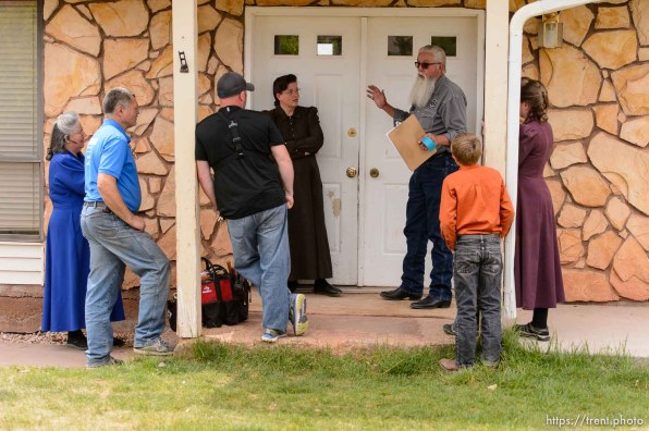 Trent Nelson | The Salt Lake Tribune An FLDS woman confronts UEP agent Ted Barlow and Mohave County Constable Mike Hoggard as they evict her from her home in Colorado City, AZ, facing eviction, Tuesday May 9, 2017. Locksmith Kelvin Holdaway in blue shirt.