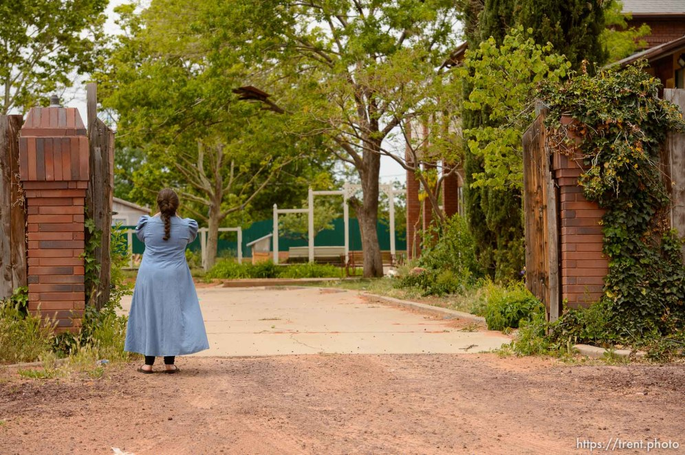 Trent Nelson   The Salt Lake Tribune An FLDS girl watches the eviction of an empty home in Colorado City, AZ, Tuesday May 9, 2017.