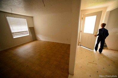 Trent Nelson | The Salt Lake Tribune An FLDS boy in a mostly empty Colorado City, AZ, home slated for eviction by the UEP Trust, Tuesday May 9, 2017. An FLDS family living in the home had moved most of their belongings out, but were still often at the home.