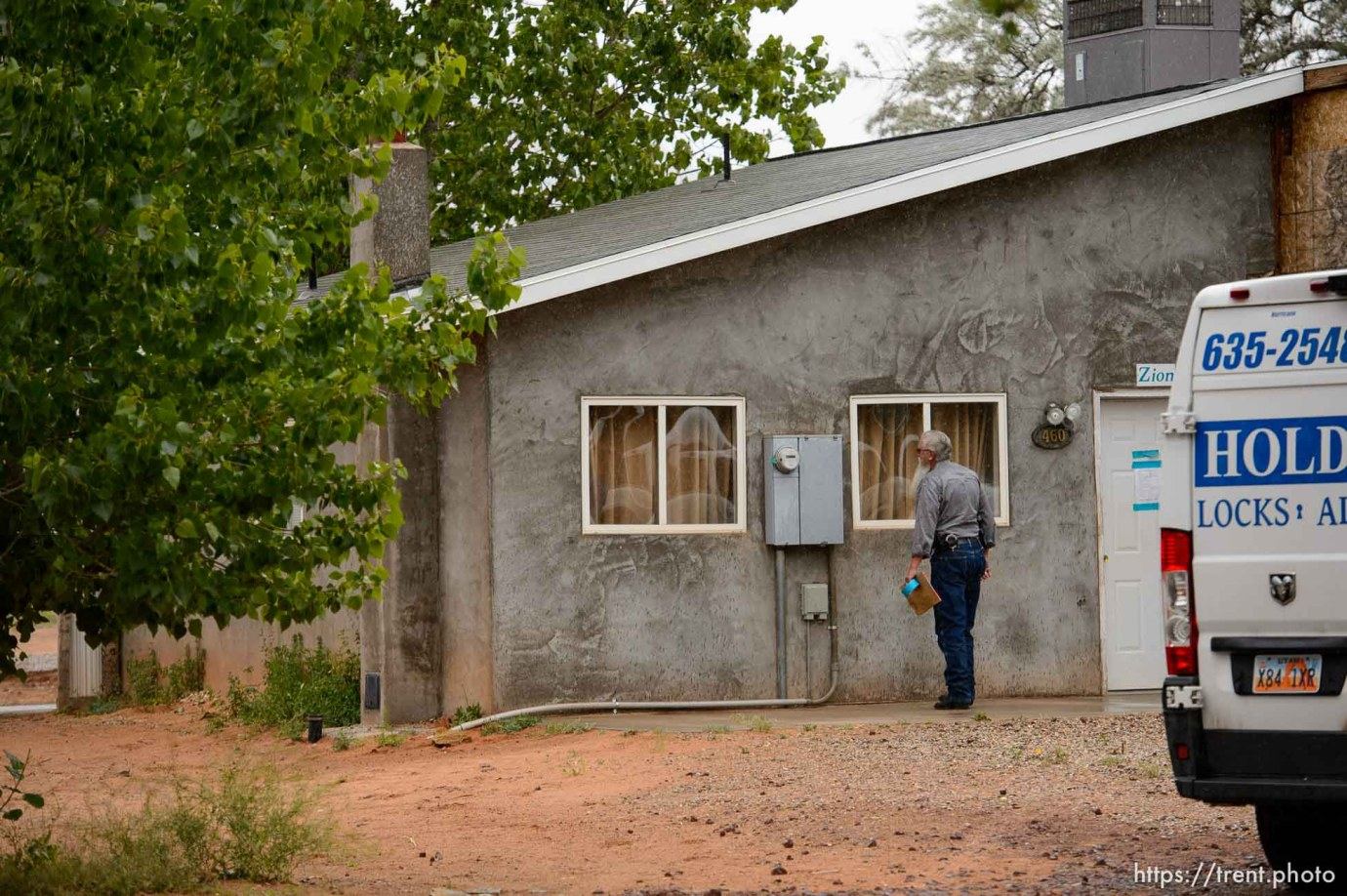 Trent Nelson   The Salt Lake Tribune Two FLDS women are evicted from a home in Colorado City, AZ, Tuesday May 9, 2017, and walk off in the rain. Mohave County Constable Mike Hoggard.