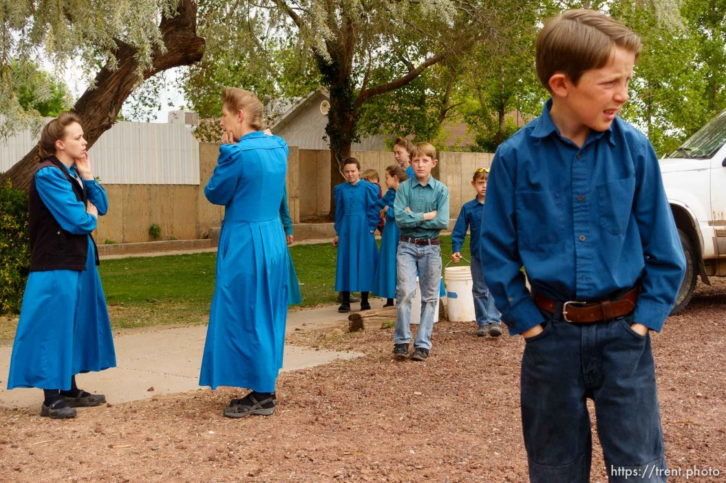 Trent Nelson   The Salt Lake Tribune As the UEP Trust evicts FLDS members from a Colorado City, AZ, home, a man tries to remove a shed and women and children look on, Tuesday May 9, 2017.