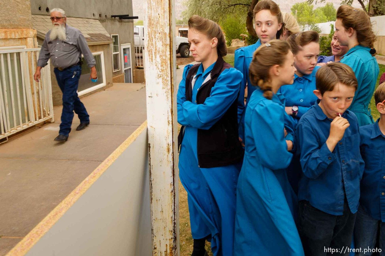 Trent Nelson   The Salt Lake Tribune A group of FLDS women and children look on as Mohave County Constable Mike Hoggard and the UEP Trust change the locks on their Colorado City, AZ, home, Tuesday May 9, 2017.