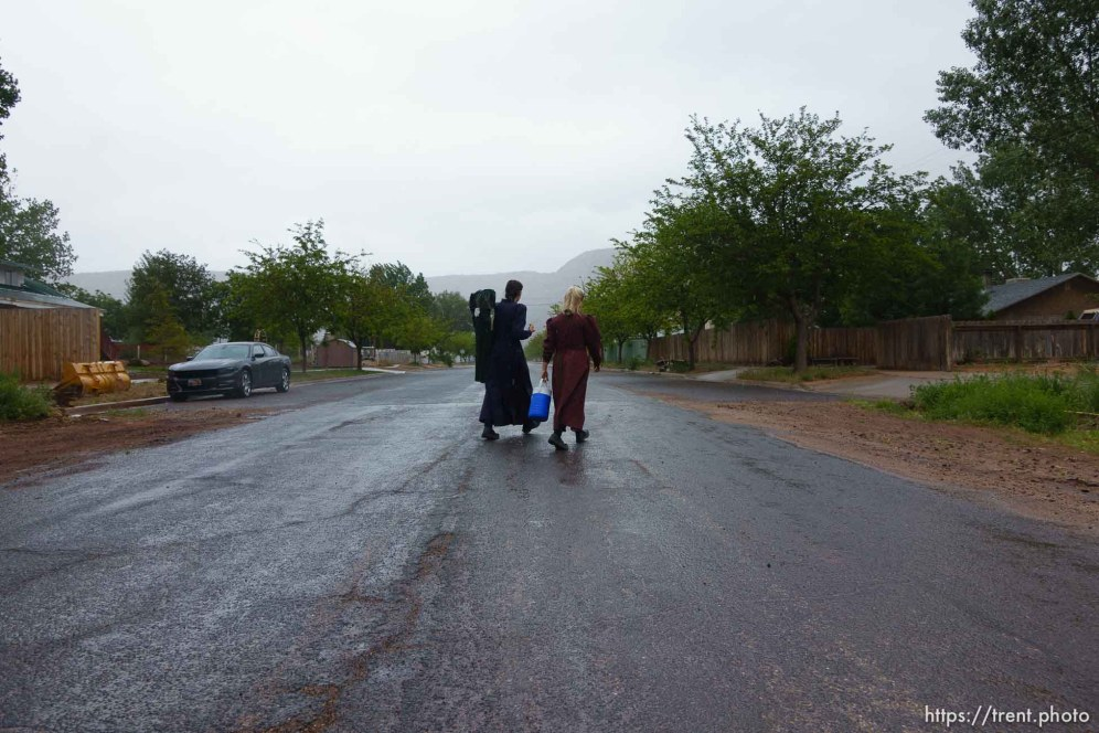 Trent Nelson   The Salt Lake Tribune Two FLDS women are evicted from a home in Colorado City, AZ, Tuesday May 9, 2017, and walk off in the rain.