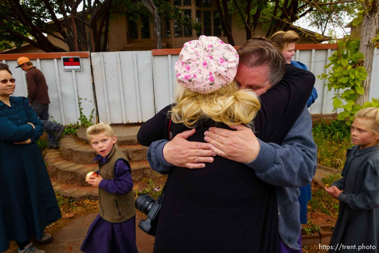 Trent Nelson   The Salt Lake Tribune Christine Marie Katas embraces an FLDS woman evicted. UEP eviction of property at 345 N Richard St, Colorado City, AZ, Wednesday May 10, 2017.