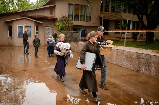 Trent Nelson | The Salt Lake Tribune UEP eviction of property at 345 N Richard St, Colorado City, AZ, Wednesday May 10, 2017. FLDS children walk out of the home.
