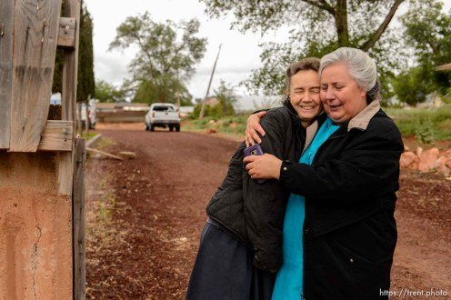 Trent Nelson   The Salt Lake Tribune Two FLDS women embrace following the UEP eviction of property at 555 N Lauritzen Ave, Colorado City, AZ, Wednesday May 10, 2017. Liz, a single mother at left, had been living in the basement of the home with her children.