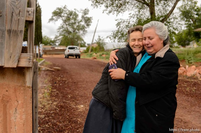 Trent Nelson | The Salt Lake Tribune Two FLDS women embrace following the UEP eviction of property at 555 N Lauritzen Ave, Colorado City, AZ, Wednesday May 10, 2017. Liz, a single mother at left, had been living in the basement of the home with her children.