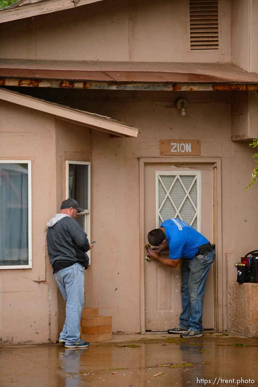 Trent Nelson   The Salt Lake Tribune UEP eviction of property at 345 N Richard St, Colorado City, AZ, Wednesday May 10, 2017. Ted Barlow, locksmith Kelvin Holdaway.