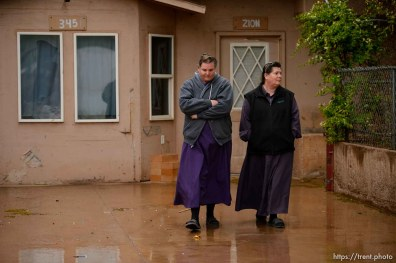 Trent Nelson | The Salt Lake Tribune UEP eviction of property at 345 N Richard St, Colorado City, AZ, Wednesday May 10, 2017. Lydia Bateman, right, leaves her home.